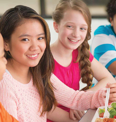 picture of children smiling and eating