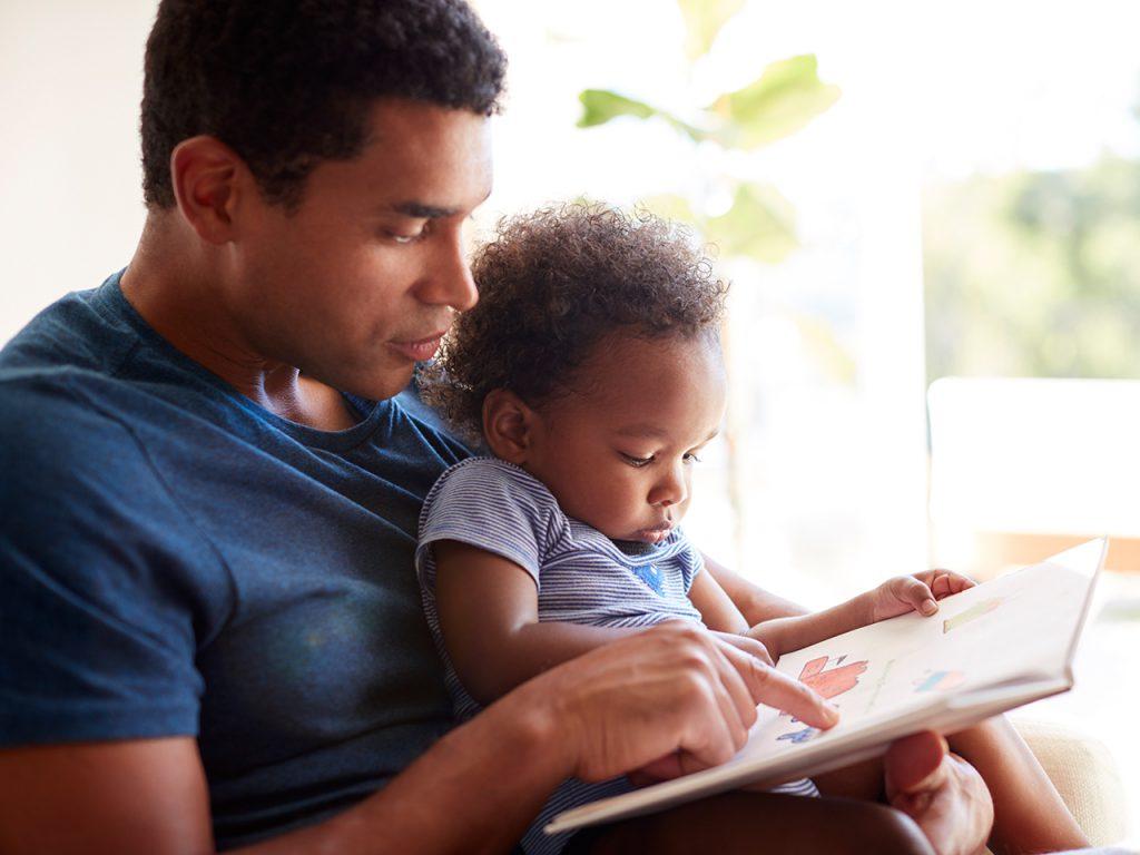 dad reading to preschooler